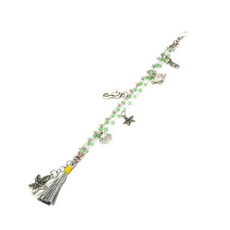 Bracciale realizzato in zamac e cristalli con nappa colorata.  Lunghezza 17/19 cm
