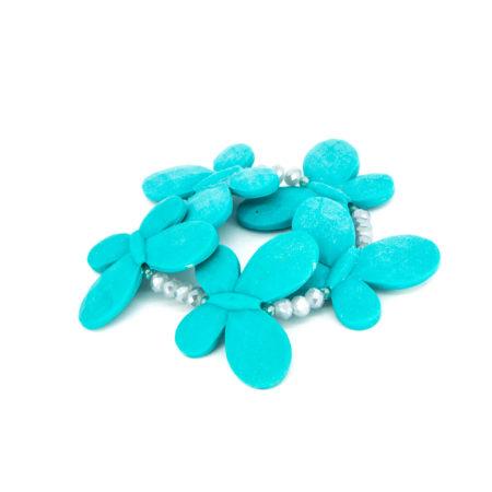 Bracciale elastico realizzato in resina e cristalli. Lunghezza 6 cm senza apertura.