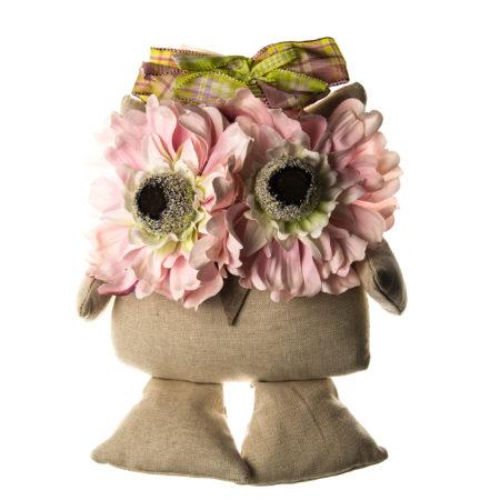 Fuoriporta in tessuto con applicazioni di fiori e fiocchi. Altezza al punto massimo  30 cm. Lunghezza al punto massimo  25 cm